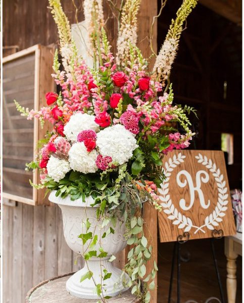 Urn filled with Eremurus, Protea, celosia, snapdragons, hydrangeas, roses, dahlias, eucalyptus, by the Garden by the Gate florists