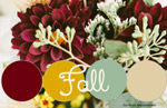 Fall wedding bouquet of burgundy dahlias, white roses, and sunflowers for a wedding at Firestone County Club