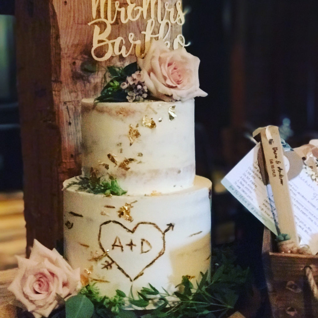 cake by LaLa Custom Cakes of Lakewood. Flowers provided by Garden by the Gate Floral Design