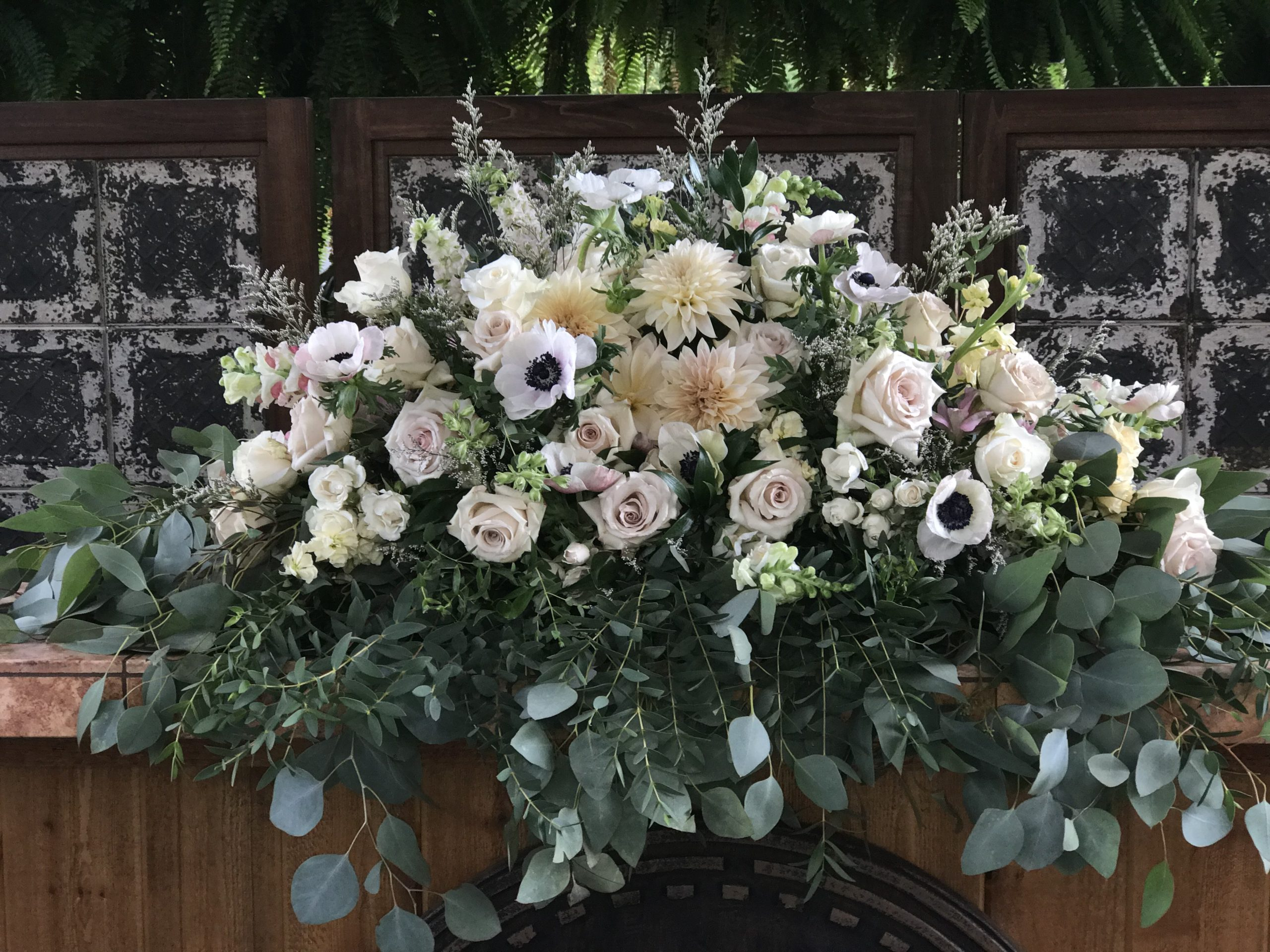 Wedding at Gervasi Vineyard. Cafe au Lait dahlis, anemones, quicksand roses in flowers by Garden by the Gate Floral Design