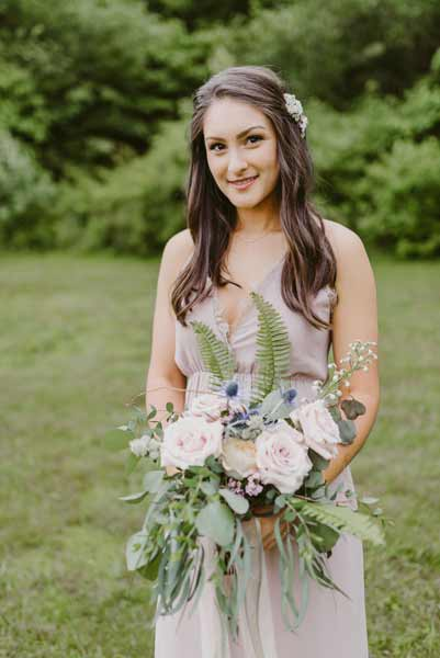 Garden roses and natural elements in a bridal bouquet by Garden by the Gate Floral Design. Photo by Mallory + Justin Photography