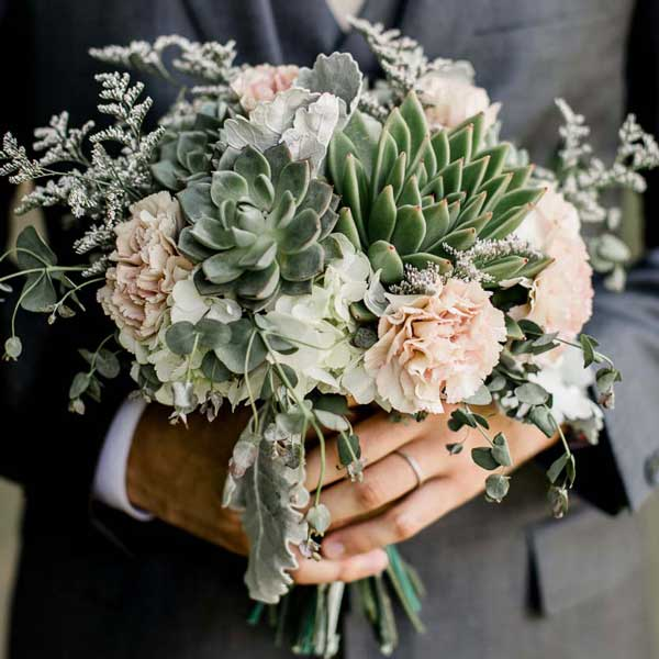 Succulent and antique carnation bouquet by Garden by the Gate Floral Design