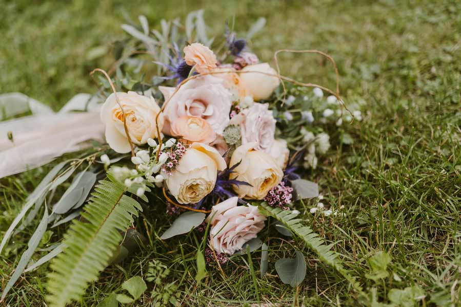 Garden roses and natural elements in a bridal bouquet by Garden by the Gate Floral Design. Photo by Mallory + Justin Photography. North Canton Wedding Florist