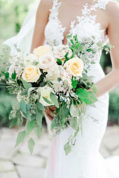 Garden roses in neutral colors make a stunning bridal bouquet. Flowers by Garden by the Gate Floral Design. Dress-The Dress Medina, Photo-Andrew Smith Photography