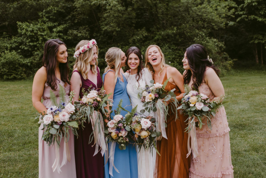 A boho wedding in the country features mis-matched bridesmaids bouquets and natural bouquets by Garden by the Gate Floral Design, Photo: Mallory + Justin Photography