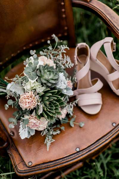 Wedding bouquet featuring succulents and antique carnations by Garden by the Gate Floral Design, North Canton