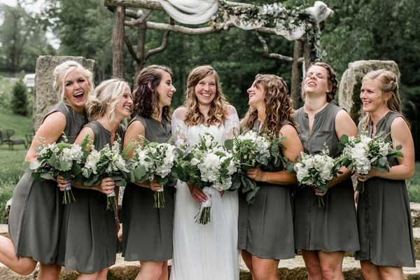 Classic white bridal bouquets with greenery by Garden by the Gate Floral Design. Venue Rivercrest Farm